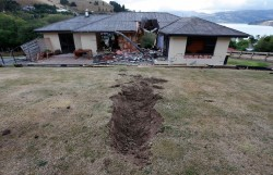 A giant boulder punched a massive hole through this house during the February 22 earthquake near Lyttelton, a suburb of Christchurch, New Zealand